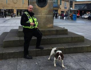 Police officer with sniffer dog in Inverness