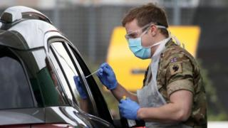 A soldier from 2 Scots Royal Regiment of Scotland assists at a testing centre amid the coronavirus disease outbreak, at Glasgow Airport