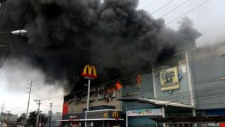 Burning shopping mall in Davao, the Philippines