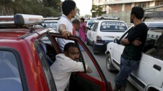 Drivers wait in a queue near a petrol station in Kathmandu. Photo: 1 October 2015