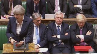 Theresa May in parliament with Phil Hammond, David Davies and Boris Johnson
