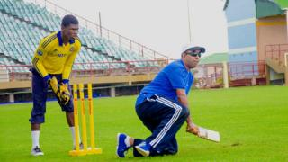 Ganesh Singh bats while kneeling on the ground