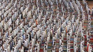 People attend Eid al-Fitr prayers to mark the end of the holy fasting month of Ramadan at a play ground in the suburb of Sale, Morocco June 26, 2017.