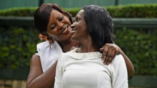 Susan Kigula and daughter today, hugging