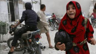 A girl cries following an air strike on the Syrian opposition-held town of Kfar Ruma, Idlib province, 30 May 2019