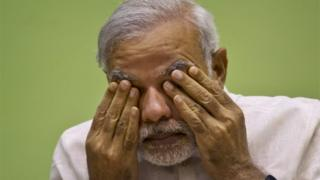 "India's Prime Minister Narendra Modi rubs his eye as he attends a conference by the environment ministry in New Delhi, India. Modi""s ruling Hindu nationalist party conceded defeat Sunday in a crucial election in Bihar, one of India""s most populous states."