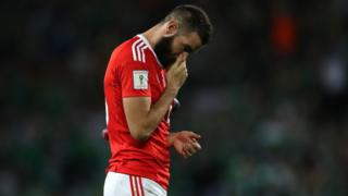 Joe Ledley looks dejected after the loss
