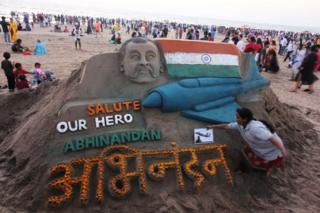 Sand art featuring Wing Commander Abhinandan Varthaman at a beach in Mumbai 2 March 2019.