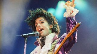 A 1985 file photo shows Prince performing at the Forum in Inglewood, California