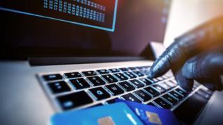 criminal uses computer keyboard