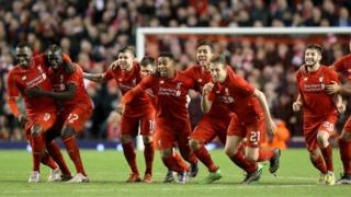 Liverpool players celebrate penalty win