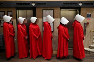 People dressed up as characters from Margaret Atwood's book The Handmaid's Tale
