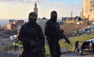 Two Spanish armed policemen wearing balaclavas in Ceuta, North Africa - Friday 13 January 2017