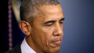 President Barack Obama frowns during a press conference on the college shooting in Oregon.