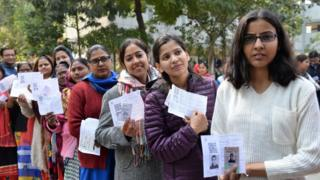 Shots of people voting during Delhi Assembly Elections, New Delhi.