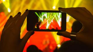 A smartphone at a gig