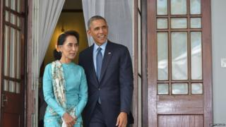US President Barack Obama and Myanmar's Aung San Suu Kyi speak during a press conference at her residence in Yangon on November 14, 2014