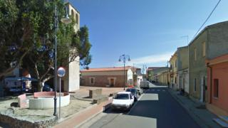 Picture shows a view of a main street and piazza in the Sardinian town of Zerfaliu.