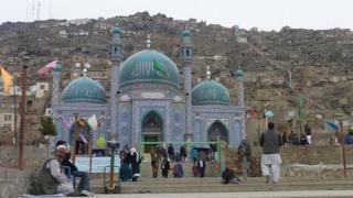 Western Kabul's blue-tiled Sakhi shrine, surrounded by steep hillsides