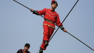 Acrobats perform on a tightrope in Beijing
