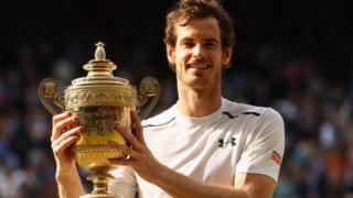 Murray holding the Wimbledon trophy