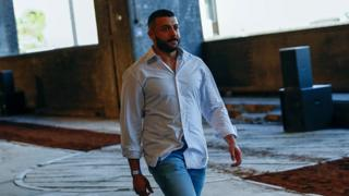 Khalid bin Sultan Al Qasimi walks the runway at the Qasimi show during London Fashion Week
