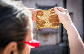 Chiara holds a piece of cloth made from byssus