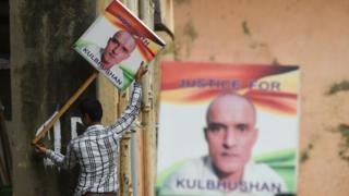 Activists in India with signs reading 'India with Kulbhushan' and 'Justice for Kulbhushan'