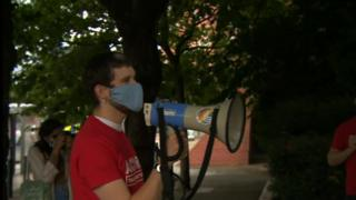 A protester holding a megaphone