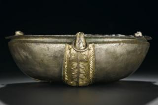 Hanging bowl of silver with three oblong gilt escutcheons in the form of spread-eagled boars Pictish from St Ninian's Isle 8th century.jpg