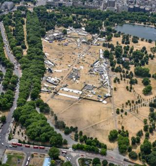 The grass in Hyde Park, London, is seen scorched and yellow