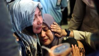 Indonesian relatives of the plane crash victims cry as they wait for the news at the airport in Pangkal Pinang, Indonesia, 29 October 2018.