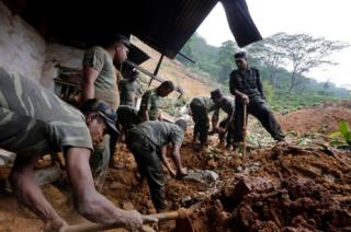 Sri Lanka Armed Forces personnel engage in rescue operations at the landslide area