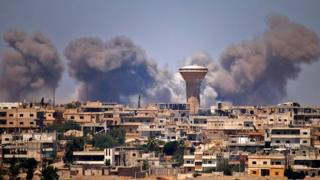 Smoke rises from a rebel-held area in the Syrian city of Deraa after a reported government air strike on 5 July 2018