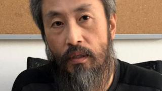 Japanese journalist Jumpei Yasuda heavily bearded in an immigration centre in Turkey