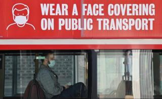 Person wearing mask on bus