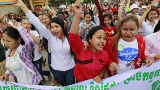 Cambodian garment workers shout slogans during a gathering at a garment factory in Phnom Penh, Cambodia, 07 October 2015