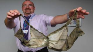A man holding a bra