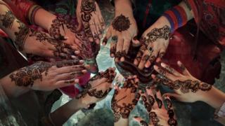 Women's hands decorated with henna