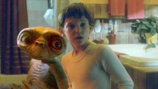 An image of Elliott and the alien E.T.