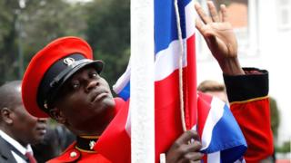 A soldier lowers the Union Jack at State House in Nairobi, Kenya - Thursday 30 August 2018