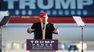Republican US presidential nominee Donald Trump rallies with supporters in a cargo hangar at Minneapolis.