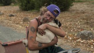 Man holds dog in California