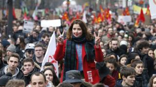 A woman flashes the V-sign as she takes part in a demonstration on 9 March 2016 in Paris, during a nationwide day of protest against proposed labour reforms
