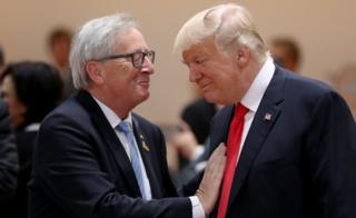 President Donald Trump and President of the European Commission Jean-Claude Juncker chat prior to the morning working session on the second day of the G20 economic summit on July 8, 2017 in Hamburg, Germany