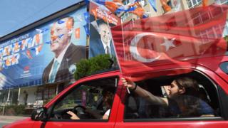 Supporters wave flags and cheer as they go to Muharrem Ince, presidential candidate of Turkey's main opposition Republican People's Party (CHP) election rally on June 23, 2018 in Istanbul, Turkey.