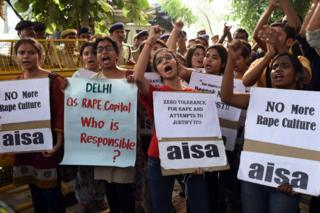 Indian students shout slogans during a protest against the rapes of two minor girls outside the police headquarters in New Delhi on October 18, 2015.