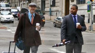 William Porter walking with one of his lawyers