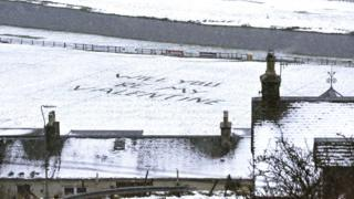 'Will you be my valentine' written in snow