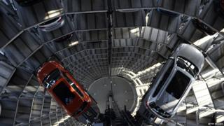 Two VW vehicles are pictured inside one of the company's so-called car towers